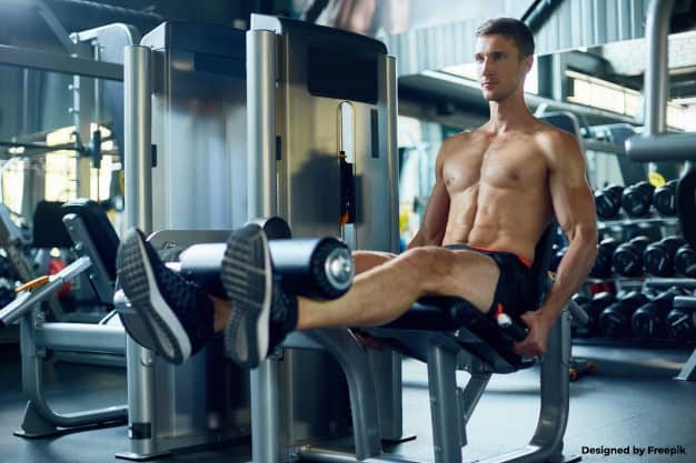 man using the leg extension machine